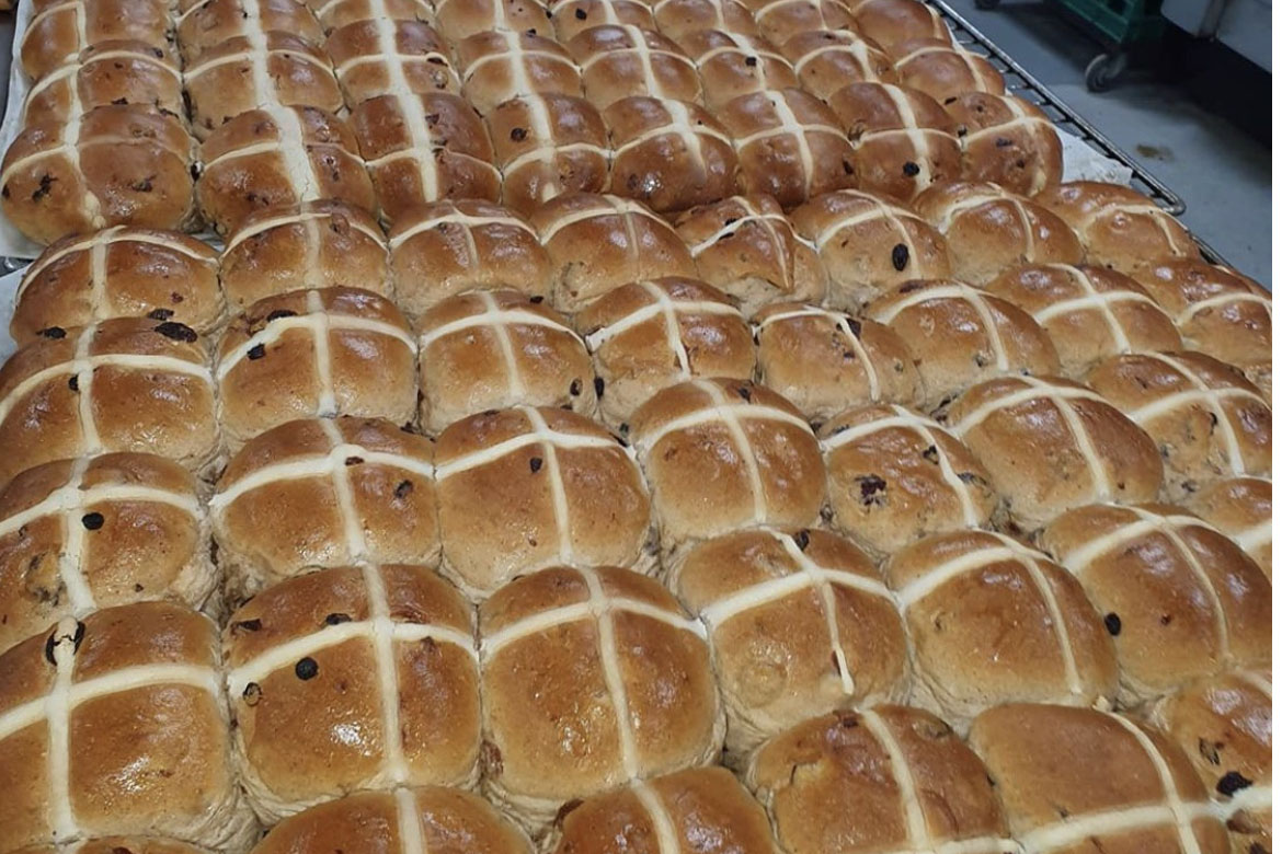Jayme baked all night to make over 1000 hot cross buns